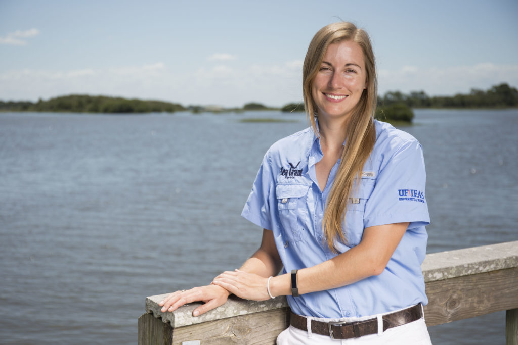 UF/IFAS Nature Coast Biological Station faculty and Sea Grant agent Savanna Barry working in Cedar Key, Florida. Photo: Tyler Jones, UF/IFAS